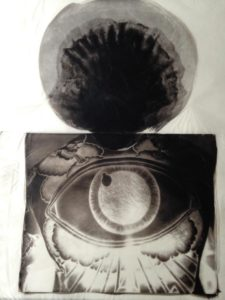 palladium print - abstract image of a eye tattoo on a man's back by Alice Garik