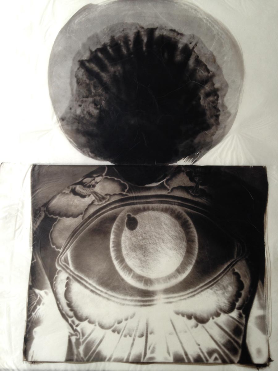 palladium print - abstract image of a eye tattoo on a man's back by Alice Garik